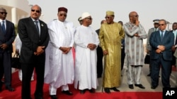 Mauritania President Mohamed Ould Abdel Aziz, Niger President Mahamadou Issoufou, Mali President Ibrahim Boubacar Keita, Chad President Idriss Deby, Burkina Faso President Roch Marc Christian Kabore pose before a working session of the African Union in Nouakchott, Mauritania, July 2, 2018.