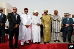 FILE: In this pictured taken Monday, July 2, 2018, left to right : Mauritania President Mohamed Ould Abdel Aziz, Niger President Mahamadou Issoufou, Mali President Ibrahim Boubacar Keita, Chad President Idriss Deby, Burkina Faso President Roch Marc Christian Ka