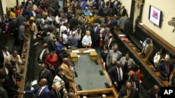 Members of the House of Assembly sit inside the Zimbabwean Parliament in Harare, Nov. 21 2017.