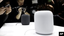 In this Monday, June 5, 2017, file photo, the HomePod speaker is photographed in a a showroom during an announcement of new products at the Apple Worldwide Developers Conference in San Jose, Calif. (AP Photo/Marcio Jose Sanchez, File)