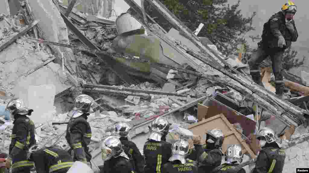 French firefighters search the rubble of a collapsed building in Rosny-Sous-Bois, near Paris, Aug. 31, 2014.