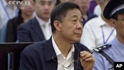 An image taken from video showing Bo Xilai in a court room in Jinan, Shandong province.
