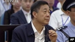 In this image taken from video, Chinese politician Bo Xilai looks up in a court room at Jinan Intermediate People's Court in Jinan, eastern China's Shandong province, Aug. 26, 2013.