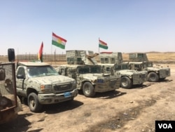 Iraqi Kurdish Peshmerga vehicles line up outside their new base in a house that they retook from IS in an offensive that pushed the frontline 23 kms closer to the IS stronghold of Mosul, June 6, 2016. (S. Behn/VOA)