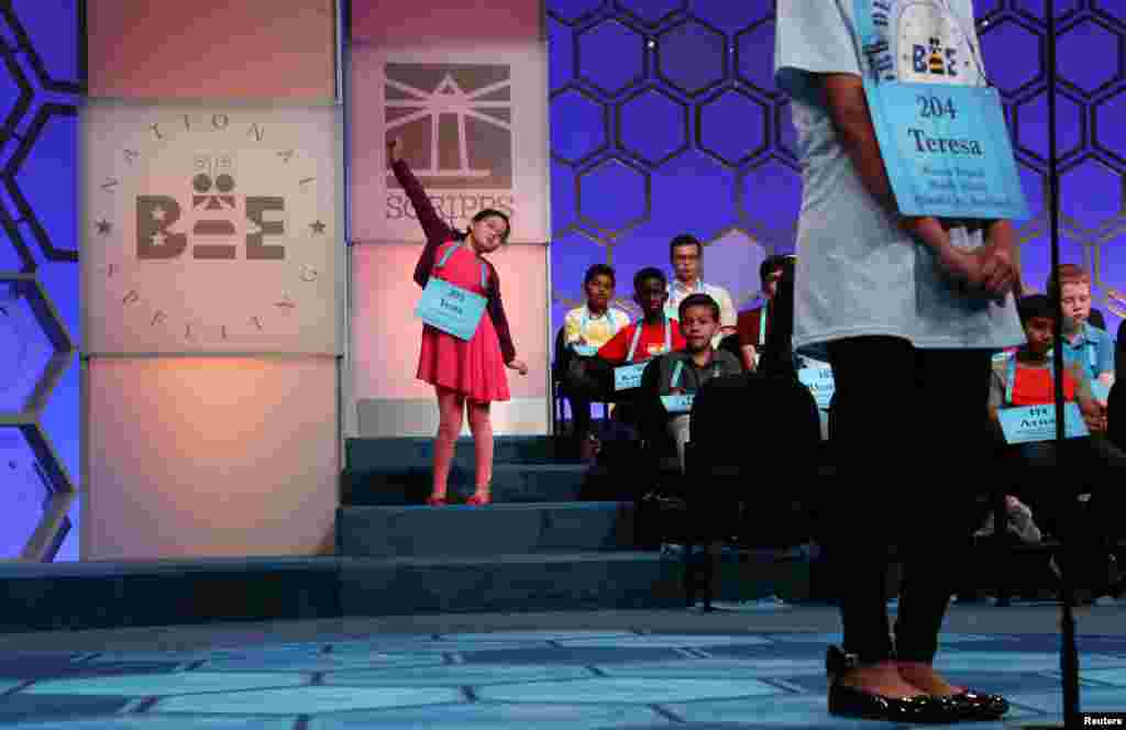 Yena Park, 10, stretches while waiting for her turn to compete in the second round of the 92nd annual Scripps National Spelling Bee in National Harbor, Maryland, May 28, 2019.
