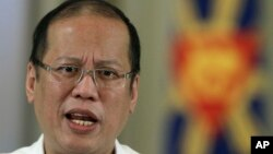 Philippine President Benigno Aquino III delivers a speech on national television at the Malacanang Presidential Palace in Manila, Philippines on Oct. 7, 2012.