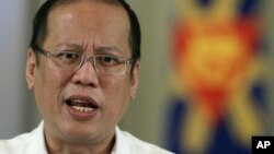 Philippine President Benigno Aquino III delivers a speech on national television at the Malacanang Presidential Palace in Manila, Philippines on Oct. 7, 2012 file photo.