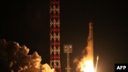 FILE - In this Wednesday, Nov. 9, 2011 file photo, the Zenit-2SB rocket with the Phobos-Ground probe blasts off from its launch pad at the Cosmodrome Baikonur, Kazakhstan. Some of the recent failures of Russian spacecraft may have been caused by hostile