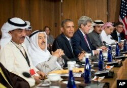 President Barack Obama sits with Kuwaiti Emir Sheikh Sabah Al-Ahmad Al-Sabah, left center, Secretary of State John Kerry, right center, and other Gulf Cooperation Council leaders and delegations at Camp David, Md., May 14, 2015.