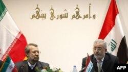علی لاریجانی در کنار سخنگوی مجلس عراق