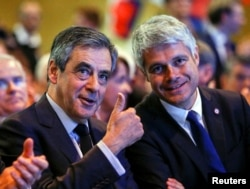 Francois Fillon, left, former French prime minister, and Laurent Wauquiez, head of the Les Republicains party, attend a political rally in Chassieu, near Lyon, France, April 12, 2017.