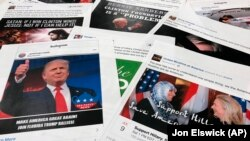 Some of the Facebook and Instagram ads linked to a Russian effort to disrupt the American political process and stir up tensions around divisive social issues, released by members of the U.S. House Intelligence committee, are photographed in Washington, D