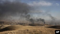 Une photo d'archives du 12 novembre 2015 près de Sinjar, dans le nord de l'Irak. (AP Photo/Bram Janssen)