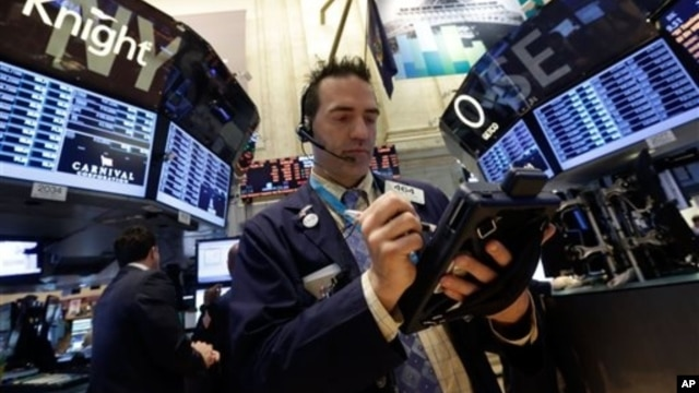 Trader Gregory Rowe on the floor of the New York Stock Exchange, May 28, 2013.