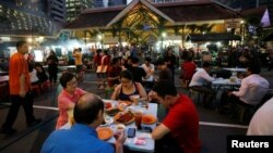 People eat at Lau Pa Sat food center in Singapore, July 29, 2016.