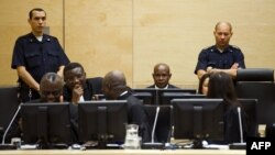 Congolese ex-militia boss Mathieu Ngudjolo, center, awaits verdict on at the International Criminal Court (ICC), The Hague, December 18, 2012.