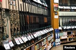 FILE - Guns for sale are seen inside of Dick's Sporting Goods store in Stroudsburg, Pennsylvania, U.S., February 28, 2018. (REUTERS/Eduardo Munoz)