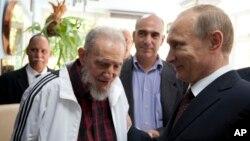 Vladimir Putin (direita) e Fidel Castro, Havana, Cuba, 2014.