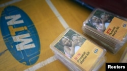 FILE - An MTN starter kit pack is seen on display on a table at a retail stand in Abuja, Nigeria, Nov. 17, 2015.
