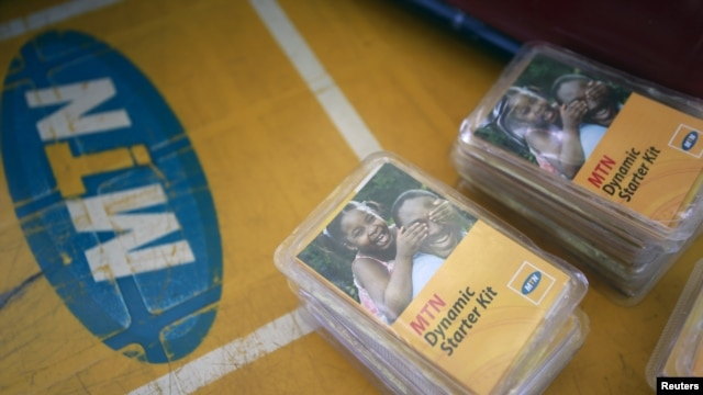 FILE - An MTN starter kit pack is seen on display on a table at a retail stand in Abuja, Nigeria, Nov. 17, 2015