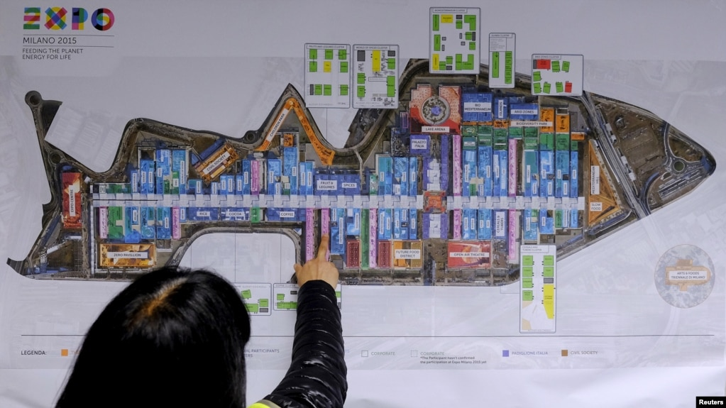 A Visitor Looks At An Expo Map Inside The Expo 2015 Work Site Near Milan