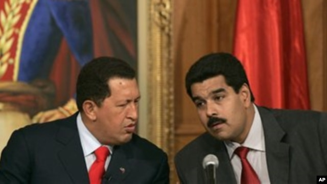 Venezuelan President Hugo Chavez, left, with his then Foreign Minister and current Vice President Nicolas Maduro, Miraflores Palace, Caracas (undated file photo).