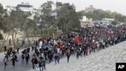 Anti-government protesters run toward Farooq Junction, also known as Pearl Square, after breaking barriers set up by police during a protest in Budaiya, west of Manama, Bahrain, February 13, 2012.