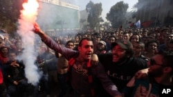 Egyptian soccer fans of Al-Ahly club celebrate a court verdict that returned 21 death penalties in last years soccer violence, which left 74 dead, inside the club premises in Cairo, Egypt, January 26, 2013.