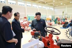 North Korean leader Kim Jong Un visits a farm machine exhibition in this undated photo released by North Korea's Korean Central News Agency (KCNA) in Pyongyang, Aug. 6, 2015.