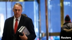 FILE - U.S. Representative Ryan Zinke (R-MT) arrives for a meeting with U.S. President-elect Donald Trump at Trump Tower in Manhattan, New York City, Dec. 12, 2016.