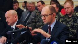 Ukraine's acting Prime Minister Arseniy Yatsenyuk speaks with local leaders in Donetsk on April 11, 2014.