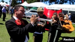 A Mariachi band plays at The Quail, a motorsports gathering, in Carmel, California, August 16, 2013.