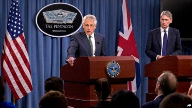 Defense Secretary Chuck Hagel, accompanied by British Defense Secretary Philip Hammond, addresses reporters following talks at the Pentagon, near Washington, May 2, 2013.