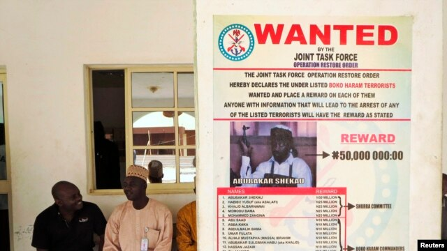 A poster advertising for the search of Boko Haram leader Abubakar Shekau is pasted on a wall in Baga village on the outskirts of Maiduguri, May 13, 2013.
