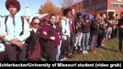 University of Missouri student protesters, led by a group called Concerned Student 1950 -- a reference to the year the university first admitted black students -- block access to Mel Carnahan quad on the campus in Columbia, Missouri, Nov. 9, 2015.