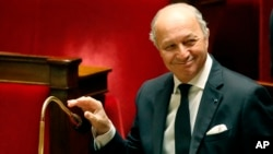 French Foreign Minister Laurent Fabius, smiles during a debate on the recognition of the Palestinian at the French Parliament in Paris, Nov. 28, 2014.
