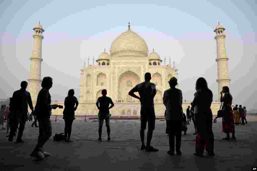 Tourists visit India's famed monument of love, the Taj Mahal, in Agra, India. The 17th century white marble monument is India's biggest tourist draw, with about 3 million visiting every year.