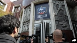 Journalists film outside the French soccer federation headquarters in Paris, May 6, 2011