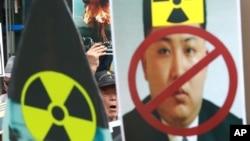 Một người Hàn Quốc hô khẩu hiệu trong cuộc biểu tình phản đối vụ thử hạt nhân mới nhất của Bắc Triều Tiên ở Seoul, Hàn Quốc, ngày 10 tháng 9 năm 2016.
