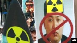 韩国民众2016年9月10游行抗议朝鲜进行核试爆。图为示威标语图案。
