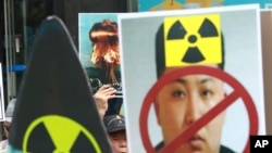 A South Korean protester shouts slogans during a rally denouncing North Korea's latest nuclear test in Seoul, South Korea, Sept. 10, 2016.