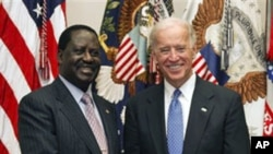 Vice President Joe Biden meets with Kenya's Prime Minister Raila Odinga, in the Roosevelt Room at the White House in Washington, April 12, 2011