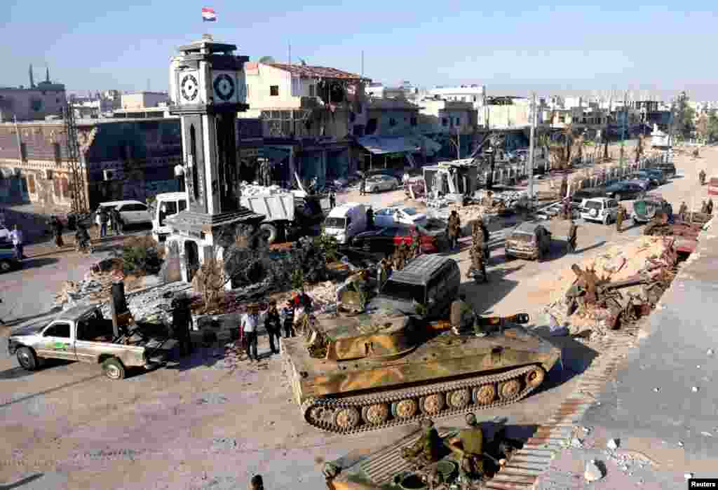 Pro-government fighters and tanks in Qusair, after the Syrian army took control of the city from rebel fighters, June 5, 2013.