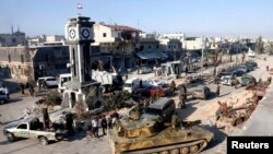 Soldiers loyal to the Syrian regime with their military tanks in Qusair, after the Syrian army took control of the city from rebel fighters, June 5, 2013.