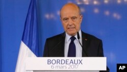 Former French prime minister Alain Juppe delivers his speech in Bordeaux, southwestern France, Monday, March 6, 2017. Juppe has confirmed that he won't be a replacement for the embattled conservative presidential candidate Francois Fillon if he decides to
