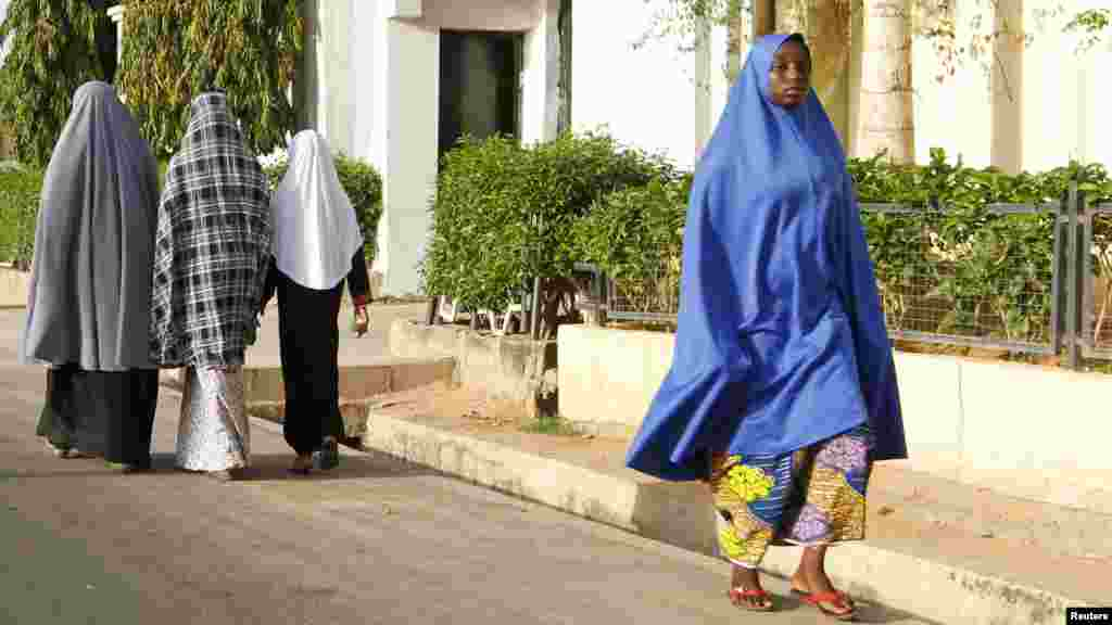 Women walk in a street in a residential area in Maiduguri, Borno State May 19, 2013.