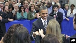 President Barack Obama shakes hands after speaking to CIA employees and thanking them for the years of effort that led to the discovery and killing of terrorist Osama bin Laden, at CIA headquarters in Langley, Va., May 20, 2011