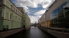 A view of the new Mariinsky Theatre (R) facing the original theater across a canal in St. Petersburg, April 30, 2013.