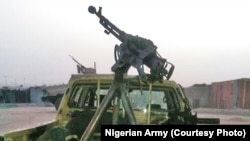 Un véhicule de Boko Haram abandonné après une attaque contre Dikwa, Borno State, Nigéria, 24 février 2016.
