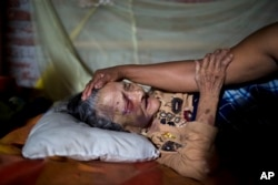 Maria Victoria, 89, is comforted by her daughter Mariana in Estancia Las Palmas, Ecuador, April 19, 2016. Maria Victoria was injured when a column fell on her after 7.8-magnitude earthquake collapsed her home.